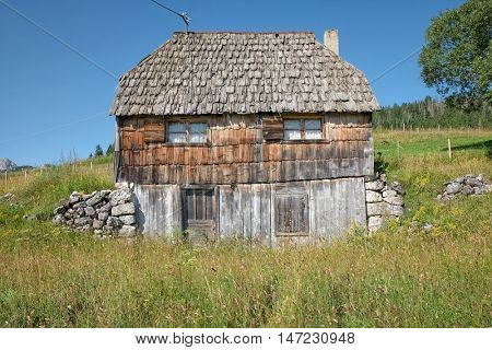 wooden house weathered in Durmitor Park, Montenegro