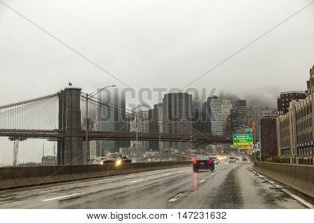 Entering New York Downtown In Heavy Rain At Brooklyn Bridge