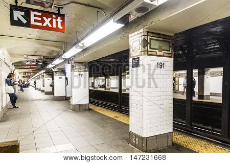 People Wait At Subway Station 191St Street In New York