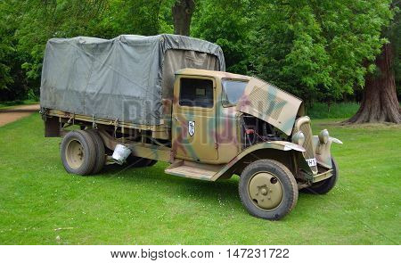 Silsoe, Bedfordshire, England - May 30, 2016: World War 2 Citroen army  truck  parked in front of trees.