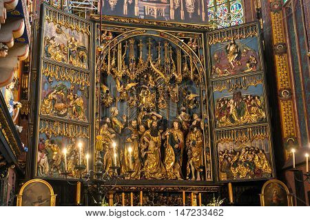 POLAND, KRAKOW - MAY 27, 2016: Opening of the main altar of the medieval St Mary's church in Krakow. St. Mary's Church was built in the XIII-XIV century.