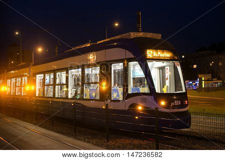 POLAND, KRAKOW - MAY 27, 2016: Night tram in the historic part of Krakow. Total in Krakow more than 90 kilometers of tram tracks and 24 routes.