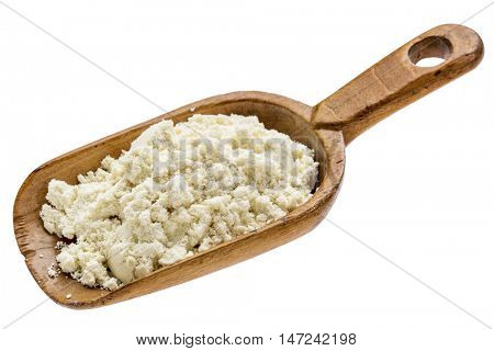 whey protein powder on  a rustic wooden scoop isolated on white