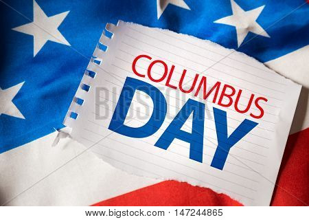 Columbus Day on notepaper and the US flag