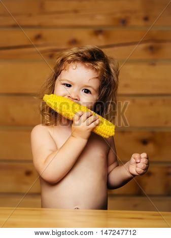 Funny Small Boy Child Eating Yellow Corn