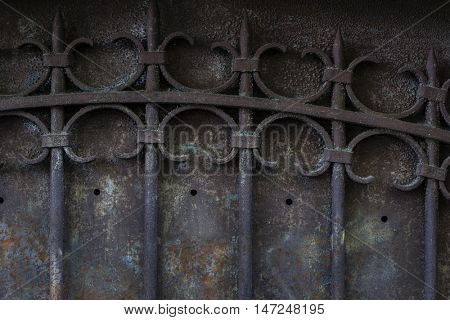 Fragment of old metal gate with ornate wrought iron grid. Toulouse, France.