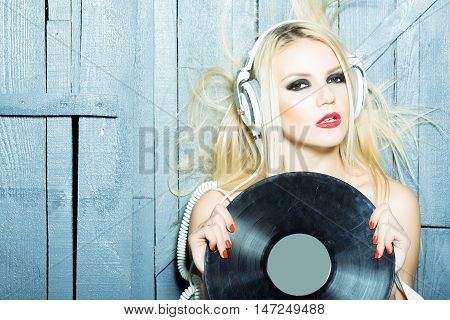 Pretty Blonde Dg Girl In Headset With Vinyl