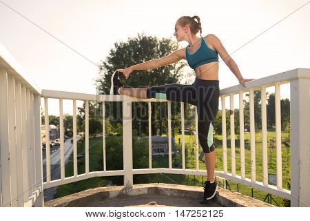 Teenage Girl Stretching Outdoors Legs