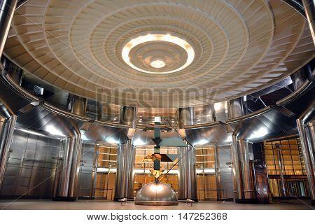 Kuala Lumpur, Malaysia - November 28, 2015. Exterior passageway at Petronas Towers in Kuala Lumpur, with doors, circular ceiling and walls.