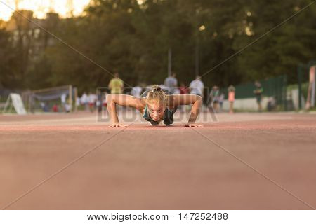 Young Teenage Girl Pushups Sport Clothes