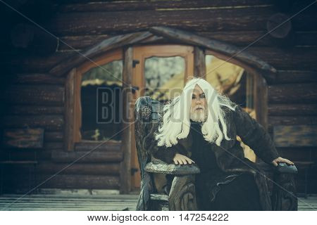 Old Wizard In Wooden Chair