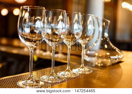 Few Empty Glasses And  Decanter Of Wine Stand On The Bar.