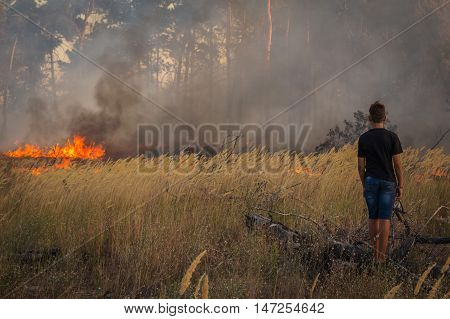 wildfire. danger a person close to the fire