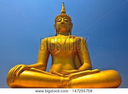 Big Buddha image on blue sky background