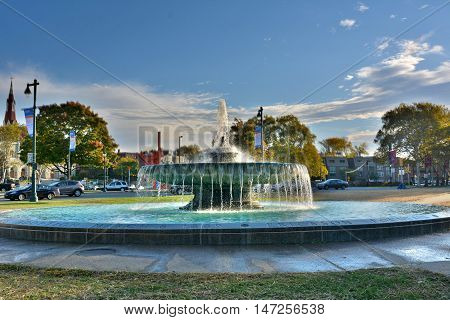 Philadelphia, Pennsylvania, USA - October 14, 2015. Ericsson fountain in Philadelphia, PA, with flowing water, surrounding buildings and street traffic