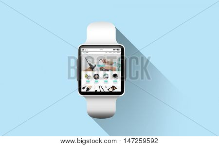 modern technology, object and shopping online concept - close up of smart watch with internet shop web page screen over blue background
