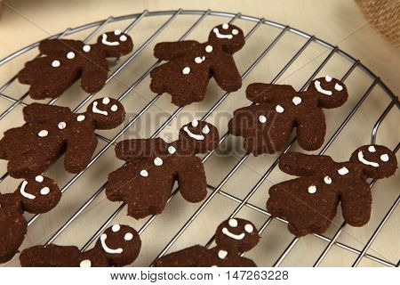 Chocolate ginger bread cookies man shape fresh from oven