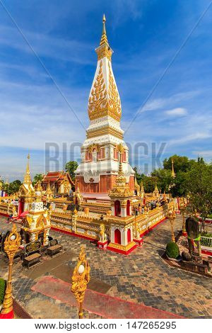 THAILAND - MAY 20 2016 : Thai people walking with lighted candles in hand around a temple candles light trail of pagoda at Phra That Phanom Temple on Visakha Bucha Day Nakhon Phanom Province Thailand