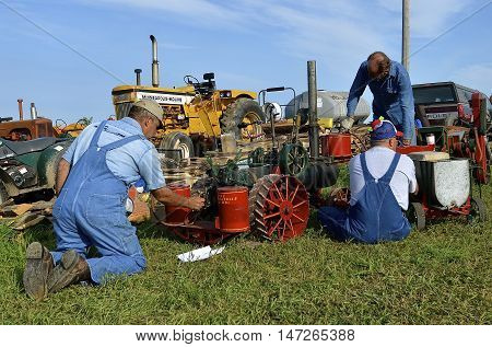 ROLLAG, MINNESOTA, Sept 1. 2016: Unidentified men feed coal into the boilers of miniature steam engines at the West Central Steam Threshers Reunion in Rollag, MN attended by 1000's held annually on Labor Day weekend.
