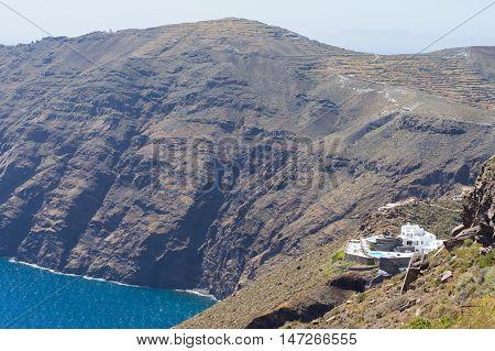 Alone luxury hotel with sea view. White architecture on Santorini island Greece. Beautiful summer landscape