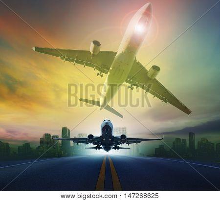 passenger plane flying against skyscraper background for transport and traveling background