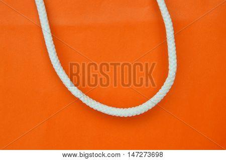 orange paper bag and white nylon handle