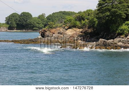 Unknown islands or rock outcrops in Casco Bay near Greater Diamond island in Maine