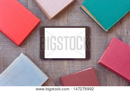 Digital tablet mock up template with books for e-book app presentation