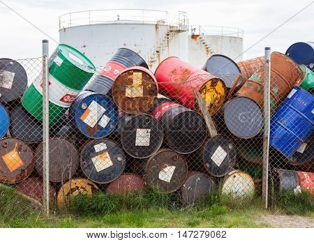 AKRANES ICELAND - AUGUST 1 2016: Oil barrels or chemical drums stacked up for cargo on August 1 2016.