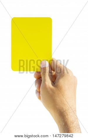 Hand of soccer referee showing yellow card on white background
