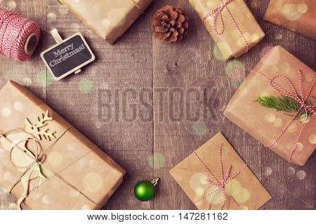 Christmas handmade wrapping gift boxes background. View from above