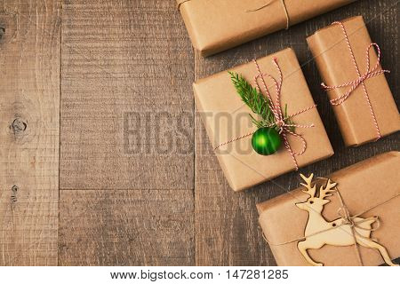 Christmas gifts on wooden background. View from above