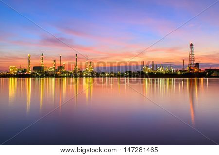 Oil refinery along the river at sunrise time (Bangkok Thailand)