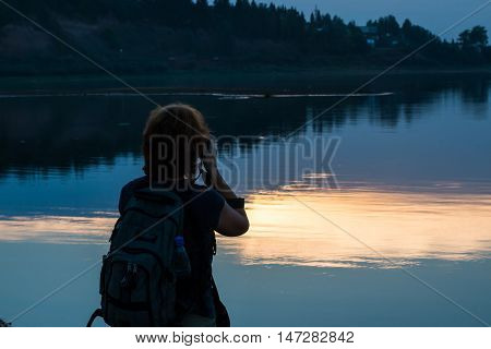 Girl Photographer Is Taking Pictures Of The Lake