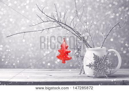 Christmas tree ornament hanging over bokeh background