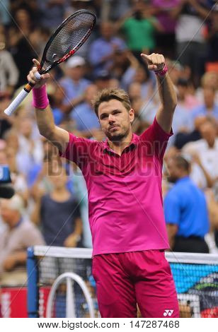 NEW YORK - SEPTEMBER 11, 2016: Three times Grand Slam champion Stanislas Wawrinka of Switzerland celebrates victory after his final match at US Open 2016 at Billie Jean King National Tennis Center