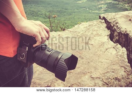 Closeup Digital Camera In Woman's Hand At View Point. Travel Lifestyle Vacations Concept