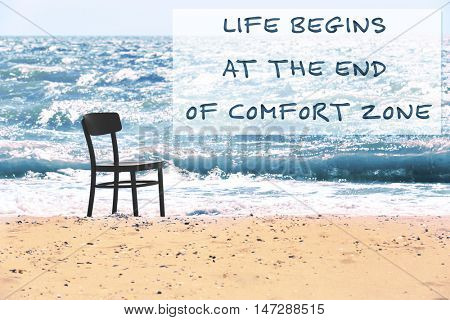 Comfort zone concept. Black chair on the beach