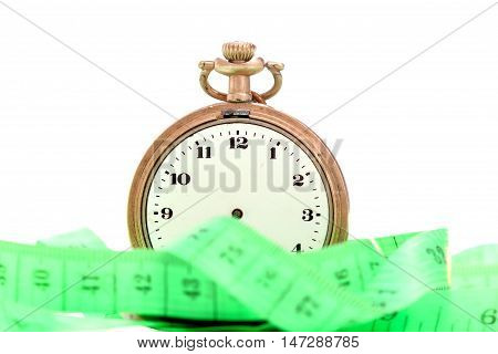 green measuring tape and pocket watch you focus on pocket watchtime and diet concept