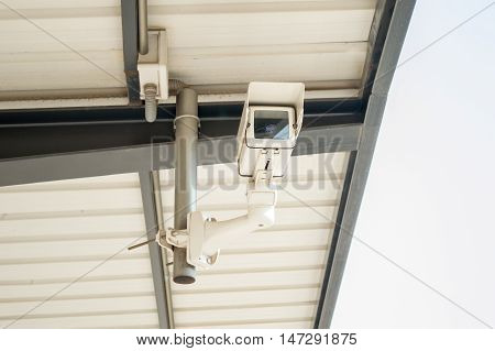 CCTV security camera on the roof of the station platform