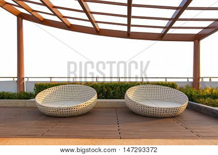 Relax corner on condominium rooftop garden with chairs on white background