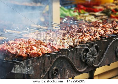 Barbecue skewers with juicy meat on brazier