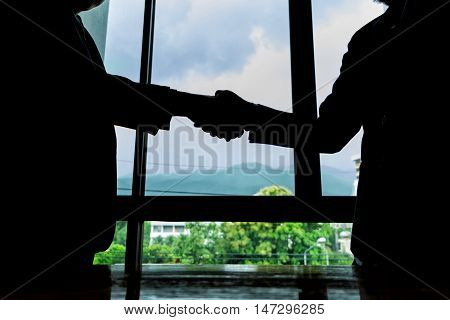 Silhouette business handshake for success business business success concept soft focus black & white tone