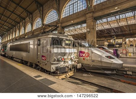 Paris France - February 15 2016: Two different type of SNCF locomotives parked in Gare du Nord Paris France on 15 February 2016