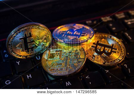 Bitcoin physical coin symbol on black keyboard