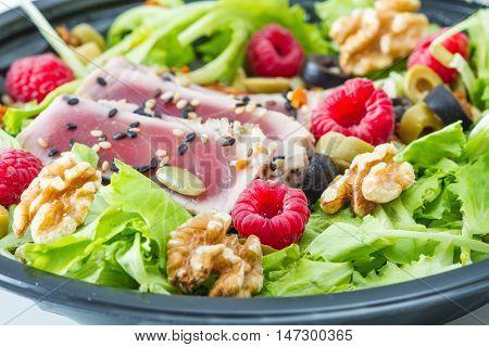 tuna sashimi with fresh salad raspberry and nut