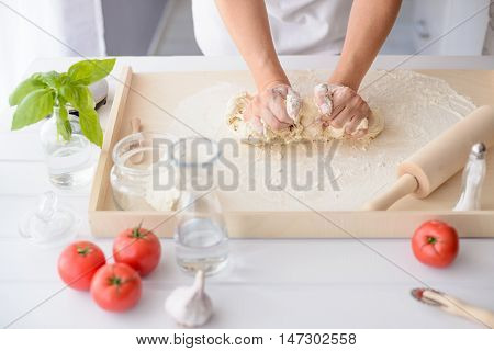 Woman Kneading Pizza Dough On Wooden Pastry Board