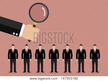 Hand holding magnifying glass to find employee. Recruitment concept