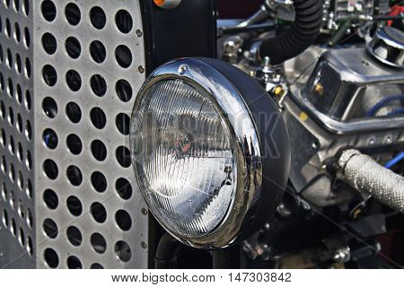 Close-up pictore of headlights on an old car