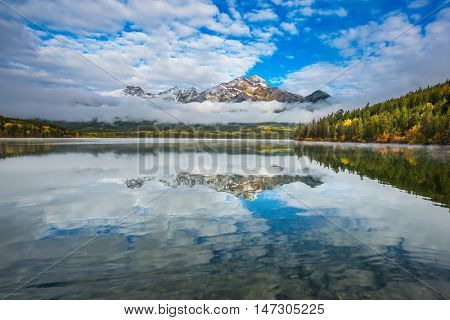 Cold morning. Pyramid Lake in the Canadian Rockies. The concept of leisure and tourism